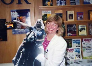 Susan Joyce in 1990 with a cutout photo of her inspirational Aunt Gladys riding a camel