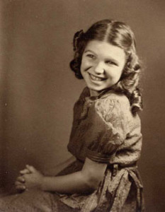 Sepia-toned photo of young Susan with long curly hair.