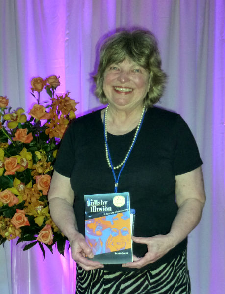 Susan Joyce receives a Gold medal for The Lullaby Illusion.